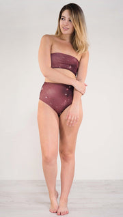 Front view of model wearing reversible high waist merlot color galaxy themed bikini bottom called Galactic Merlot on this side