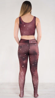 Back view of model wearing a merlot color galaxy themed triathlon leggings