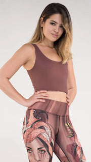 Girl wearing reversible top with the solid mauve color on the outside. WERKSHOP logo on the wearer's bottom left sweep.