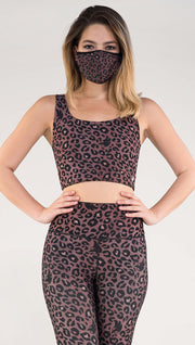 Front view of model wearing the Tan/ Red Leopard Top in the Red Leopard side in the colors dusty red and black