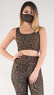 Front view of model wearing the Tan/ Red Leopard Top in the Tan Leopard side in the colors tan and black