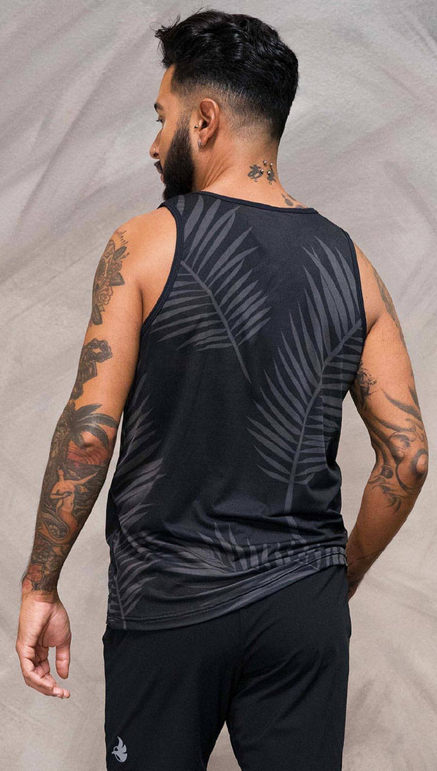 Close up back view of model wearing black tank top with white palm art