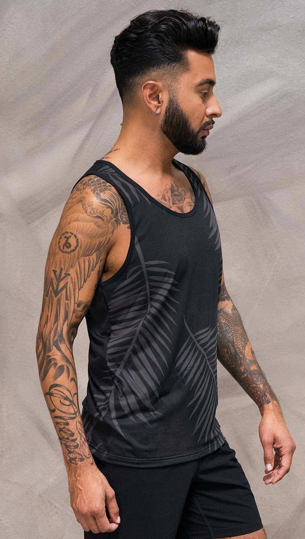 Close up right side view of model wearing black tank top with white palm art