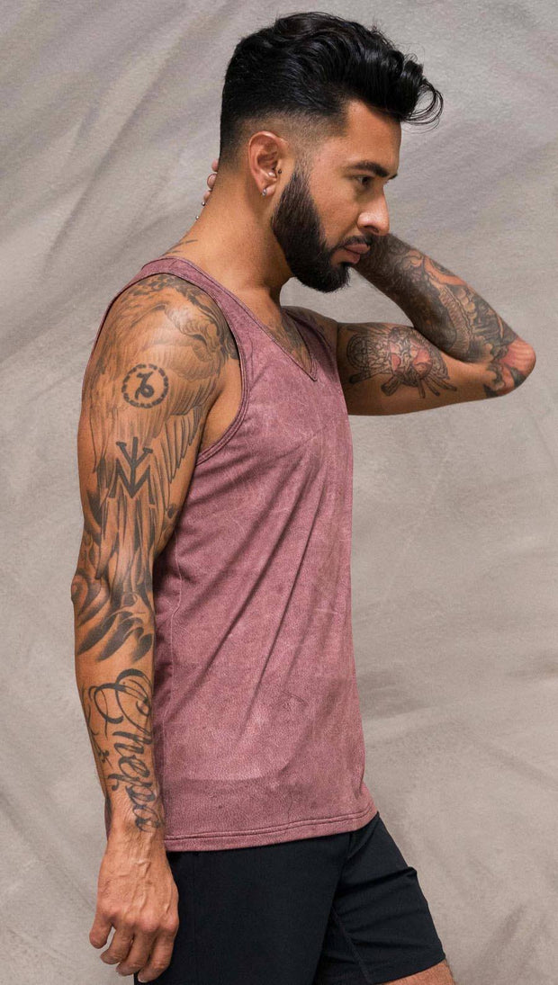 Close up right side view of model wearing brick red printed tank top