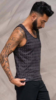 Close up right side view of model wearing charcoal black printed tank top with distressed tribal inspired art