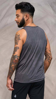 Close up back view of model wearing gray tank top