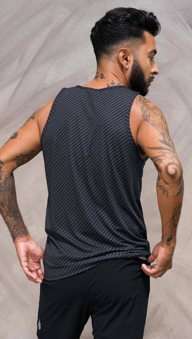 Close up back view of model wearing black tank top with carbon fiber inspired art