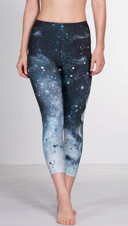 front view of model wearing moon cycle design printed capri leggings