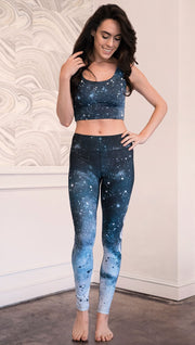 front view of model wearing moon cycle themed full length leggings