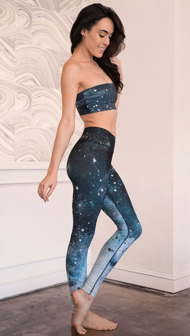 right side view of model wearing moon cycle themed full length leggings
