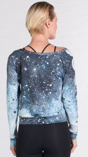 closeup back view of model wearing moon cycle themed printed pullover shirt