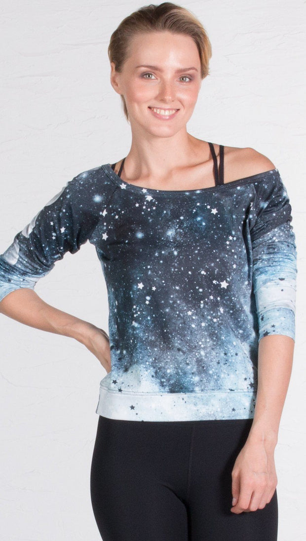 closeup front view of model wearing moon cycle themed printed pullover shirt