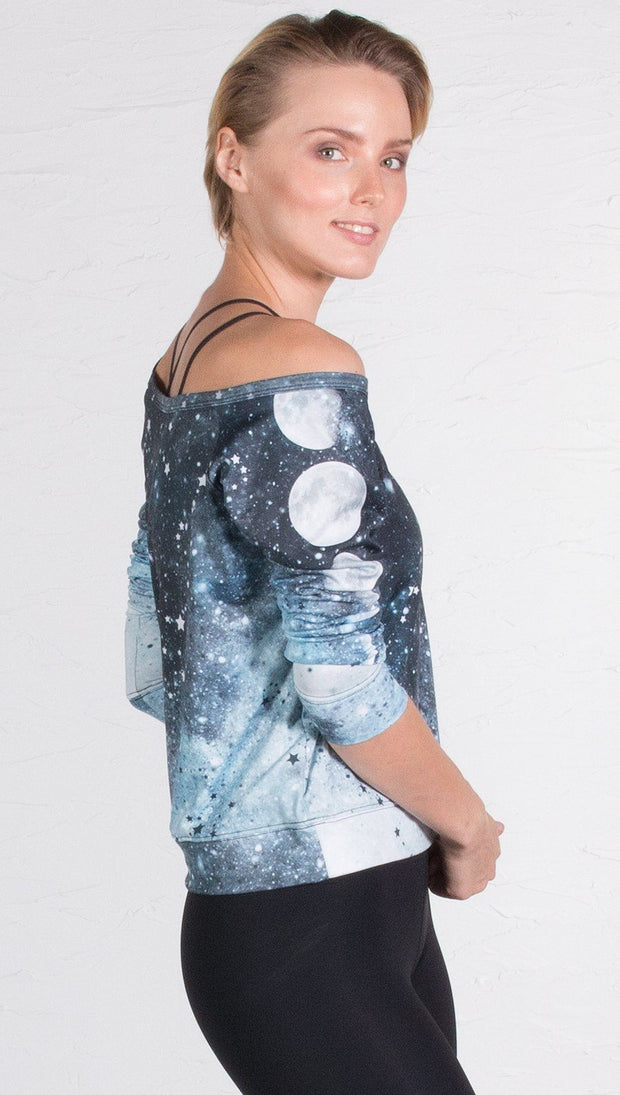 closeup right side view of model wearing moon cycle themed printed pullover shirt