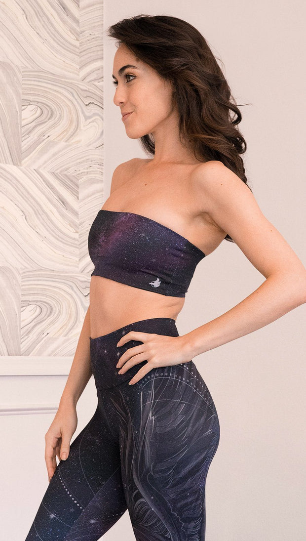 Left side view of model wearing bandeau top with ethereal dark blue water print on one side and textured watercolor print on the reverse side