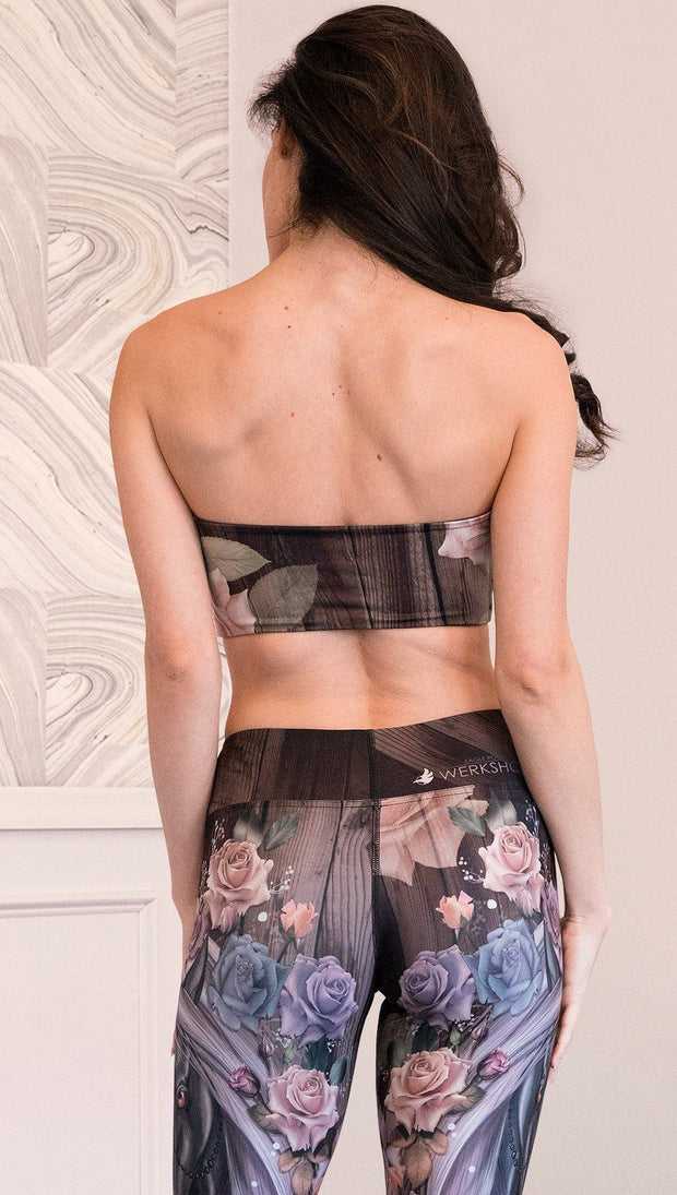 back view of model wearing unicorn themed bandeau sports top