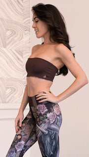 left side view of model wearing unicorn themed bandeau sports top