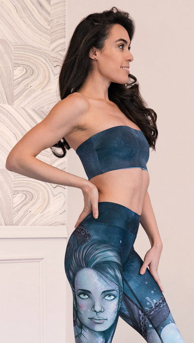 close up right side view of model wearing reversible bandeau top with ethereal dark blue water print on one side and textured watercolor print on the reverse side