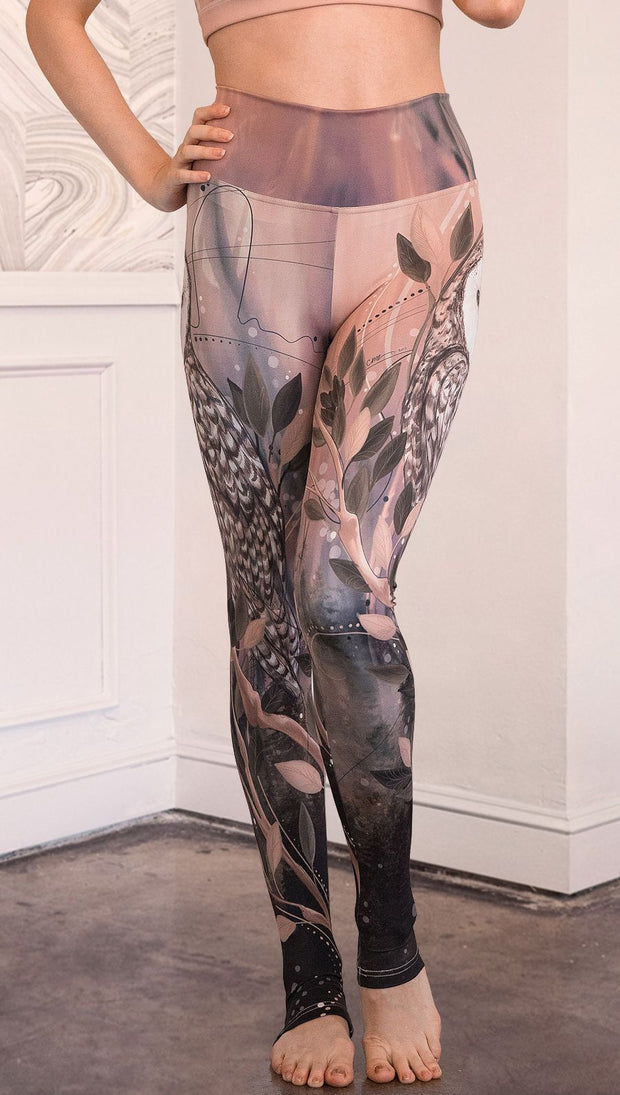 closeup front view of model wearing owl themed full length leggings
