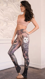 front view of model wearing owl themed full length leggings
