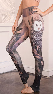 closeup left side view of model wearing owl themed full length leggings