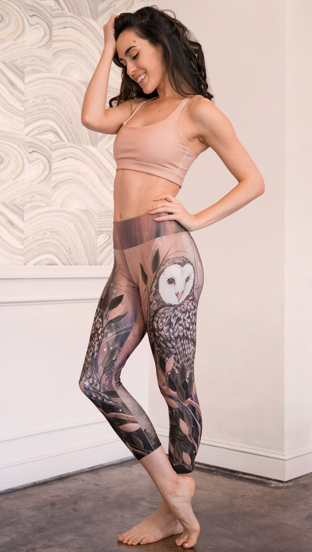 left side view of model wearing owl themed capri leggings