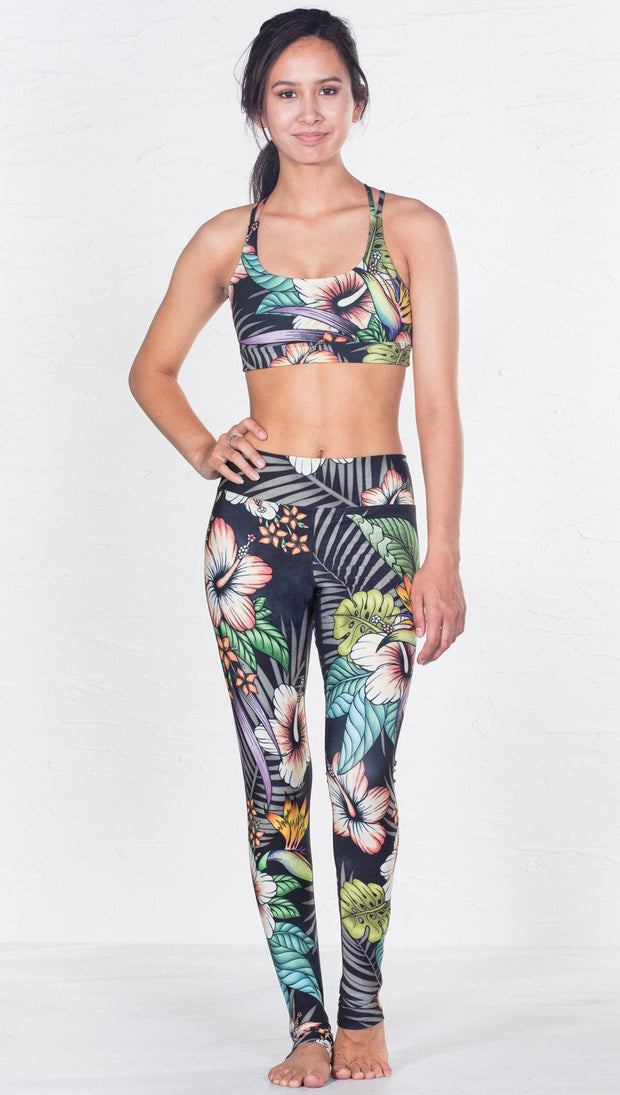 front view of model wearing tropical flower inspired printed sports bra