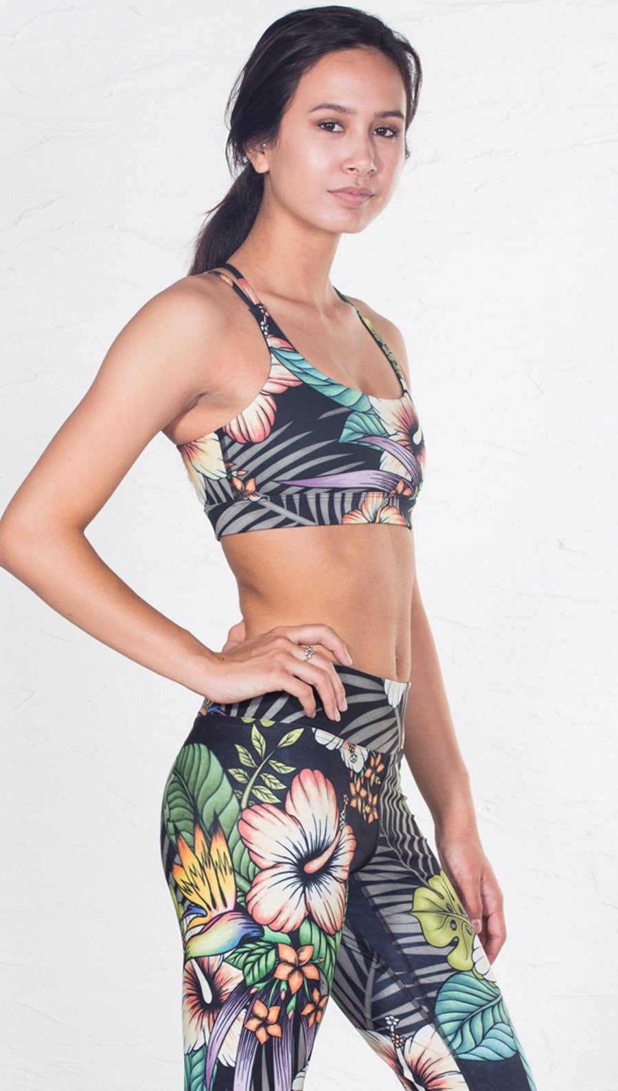 front view of tropical flower inspired printed sports bra