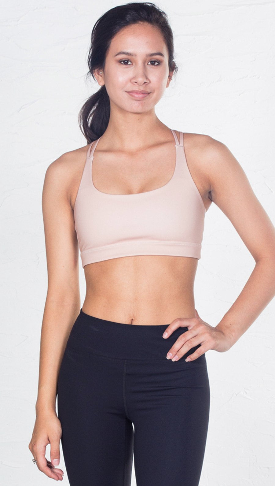 front view of model wearing nude/beige sports bra