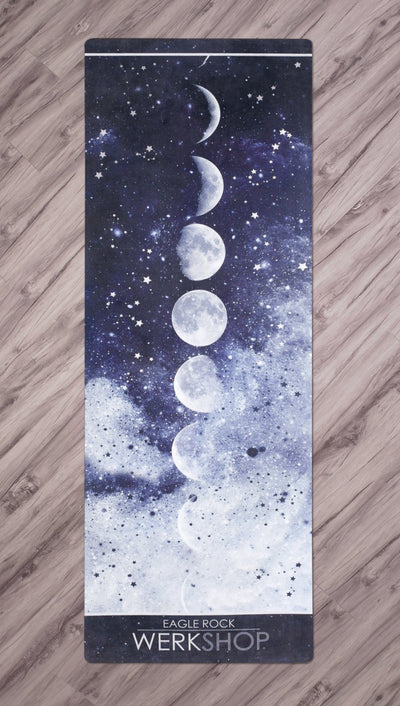 full top view of moon cycle themed yoga mat