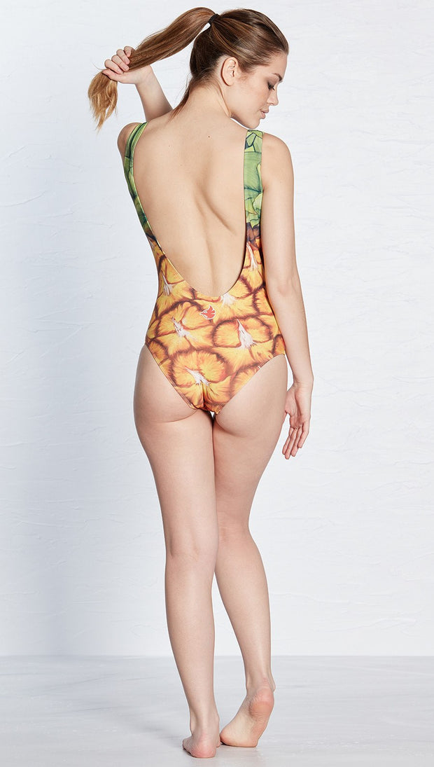 back view of model wearing pineapple themed one piece swimsuit / leotard