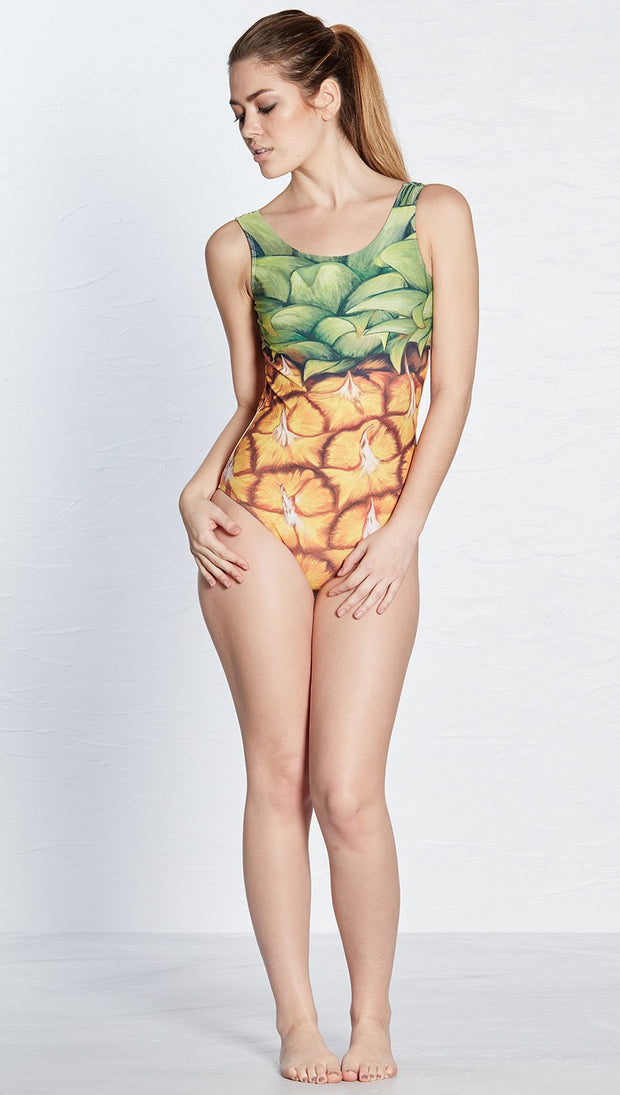 front view of model wearing pineapple themed one piece swimsuit / leotard