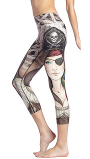close up side view of model wearing pirate girl themed printed capri leggings