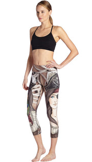 front view of model wearing pirate girl themed printed capri leggings