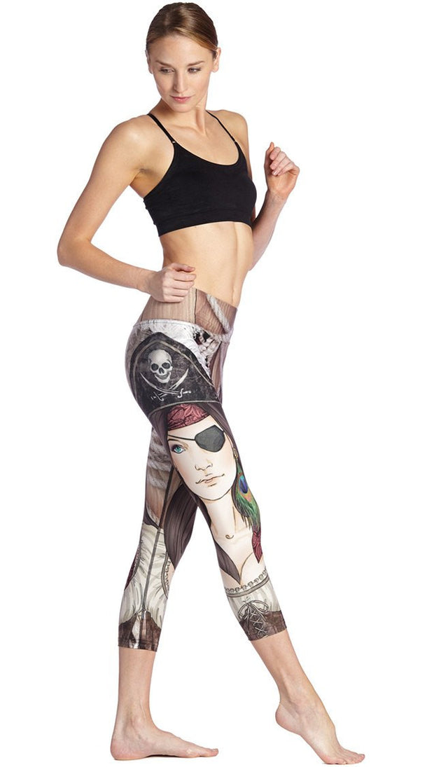 right side view of model wearing pirate girl themed printed capri leggings