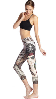 left side view of model wearing pirate girl themed printed capri leggings