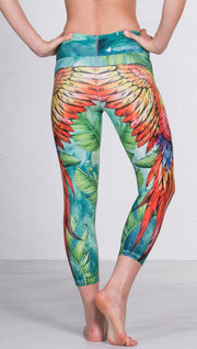 closeup back view of model wearing macaw themed capri leggings