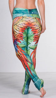 closeup back view of model wearing macaw themed full length leggings