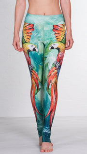 closeup front view of model wearing macaw themed full length leggings