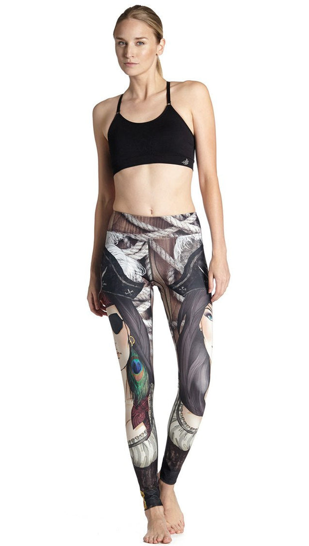 front view of model wearing pirate girl themed printed full length leggings