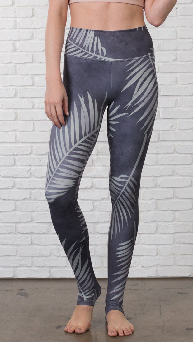 closeup front view of model wearing tropical palm front printed full length leggings