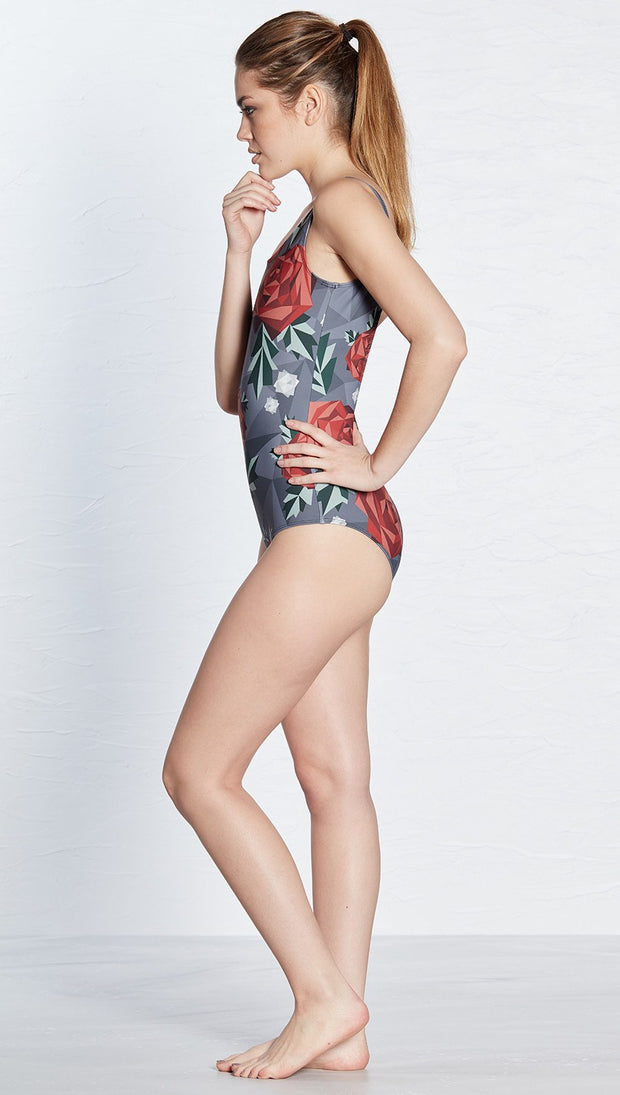 left side view of model wearing geometric rose themed one piece swimsuit / leotard