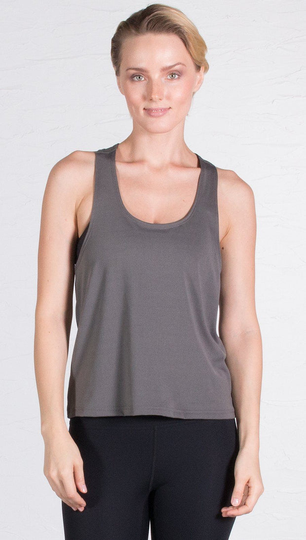 closeup front view of model wearing gray sports tank top