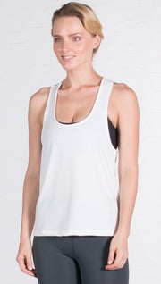 closeup front view of model wearing white sports tank top