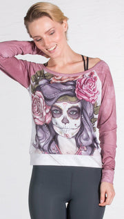 closeup front view of model wearing sugar skull printed pullover