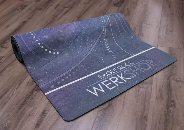 view of partially rolled pegasus inspired design yoga fitness mat