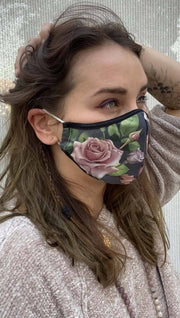 Right side view of model wearing a grey mask with pink roses and green leaves