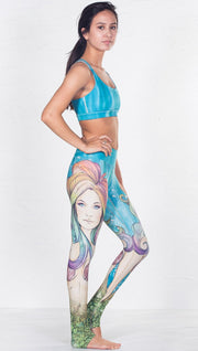 closeup right side view of model wearing aqua / ocean inspired printed sports bra