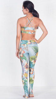 back view of model wearing tropical flower inspired printed sports bra