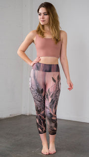 front view of model wearing owl themed capri leggings