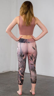 back view of model wearing owl themed capri leggings